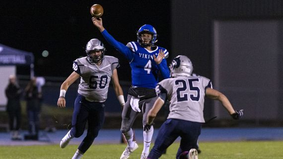 Quarterback Jack Prka leads Coeur d'Alene into the Idaho state 5A playoffs, which start Friday. The Vikings have a bye this week and will host a quarterfinal game next week.  (Cheryl Nichols/For The Spokesman-Review)