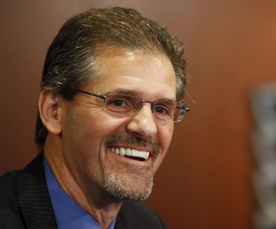 In this May 2014 photo, Philadelphia Flyers general manager Ron Hextall laughs during an NHL hockey news conference in Philadelphia. Mario Lemieux and the Pittsburgh Penguins are turning to a former rival to help them keep the Stanley Cup window open for Sidney Crosby and company. The team hired former Philadelphia Flyer goaltender and general manager Ron Hextall as the team's general manager on Tuesday, Feb. 9, 2021.  (Associated Press)