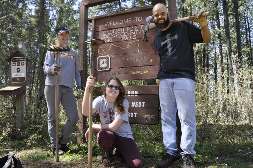 Clover Langdale, Christi Turmes and Joe Turmes of Nampa, Idaho, made a weekend road-trip to Coeur d'Alene to see the countryside and chip in with Idaho Trails Association work project at English Point trails in Hayden.  (Rich Landers)