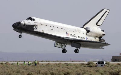 Space shuttle Atlantis comes in for a landing Sunday at the NASA Dryden Flight Research Center at Edwards Air Force Base, Calif., ending the  mission  to repair the Hubble Space Telescope.  (Associated Press / The Spokesman-Review)