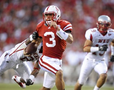 Nebraska quarterback Taylor Martinez is averaging 13.5 yards per carry through two home games. (Associated Press)