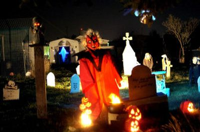 Wilson's yard  is transformed into a graveyard complete with monsters, ghosts and ghouls. On Halloween night trick-or-treaters are welcome  to wander through the graveyard.   (The Spokesman-Review)