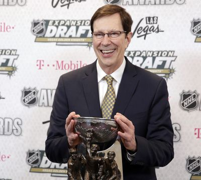 FILE - In this June 21, 2017, file photo, David Poile, general manager of the Nashville Predators, poses with the NHL General Manager of the Year Award after winning the honor at the NHL Awards in Las Vegas. Poile headlines the 2018 class of the U.S. Hockey Hall of Fame. (AP Photo/John Locher, File) ORG XMIT: NY171 (John Locher / AP)