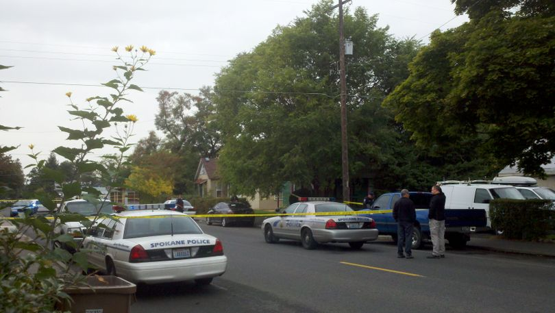 Spokane police on scene of an attempted murder/suicide at the green house, located in the 3100 block of East 5th Avenue, on Monday, Oct. 10, 2011. (Meghann Cuniff / The Spokesman-Review)