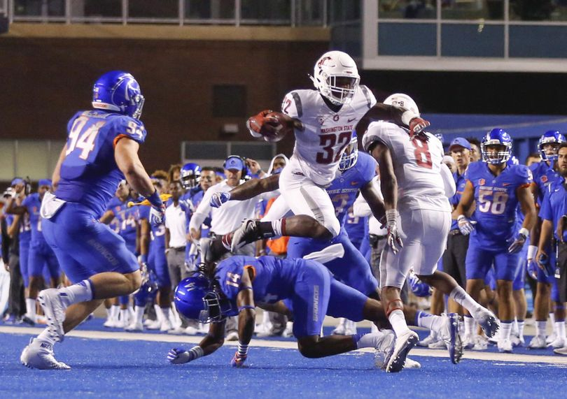 Washington State running back James Williams leaps over Boise State cornerback Tyler Horton in the first half on Saturday in Boise, Idaho. (Otto Kitsinger / Associated Press)