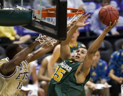 USF's Cole Dickerson averages double-double. (Associated Press)