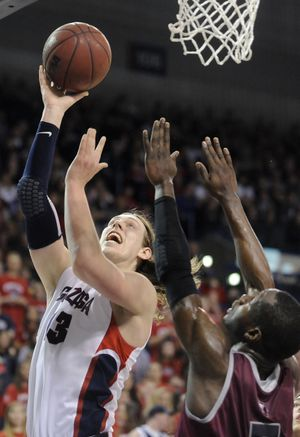 Gonzaga forward Kelly Olynyk (13) shoots against Loyola Marymount during the first half of a college basketball game on Saturday, February 9, 2013, in Spokane, Wash. (Tyler Tjomsland / The Spokesman-Review)