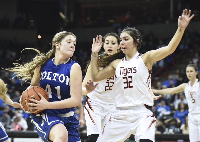Colton's Meghan Dvorak, left, looks for a passing lane against Republic's Shania Graham during the girls State 1B title game in the Spokane Arena on Saturday. (Tyler Tjomsland / The Spokesman-Review)