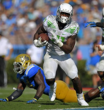 True freshman running back Royce Freeman has provided balance to the Oregon offense in its pursuit for a national playoff spot. (Associated Press)