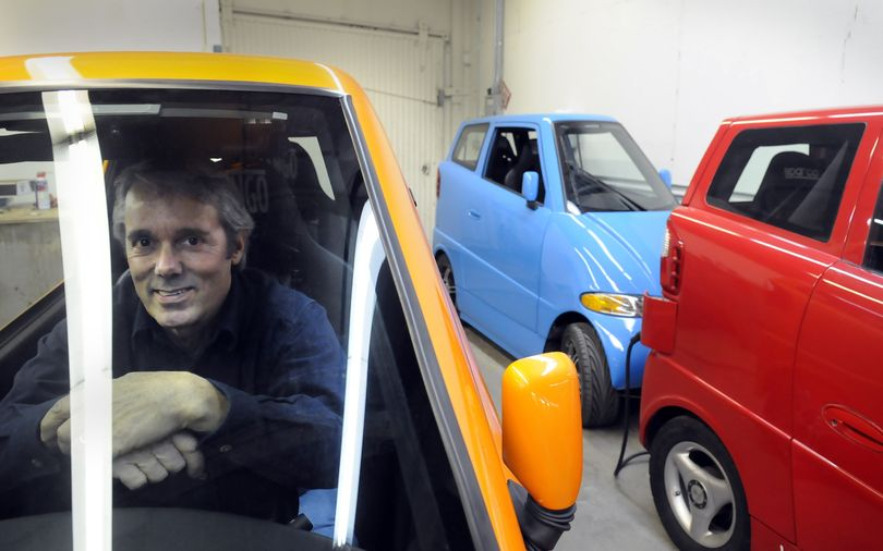 Rick Woodbury sits in a Tango electric car at his E. Sprague shop where he builds the high-performance commuter cars Tuesday, Dec. 22, 2009. He's had an eventful year that included finishing cars for the Google founders and his car competing for the automotive Xprize.  He is sitting in one of Sergey Brin's three Tangos. (Jesse Tinsley / The Spokesman-Review)