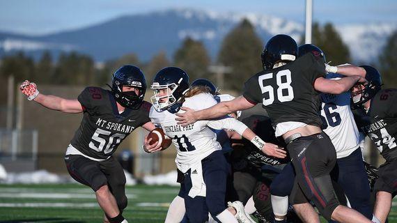 Gonzaga Prep quarterback Ryan McKenna carries against Mt. Spokane at Union Stadium on Feb. 27. G-Prep held on to win 10-7.  ( James Snook/For The Spokesman-Review)