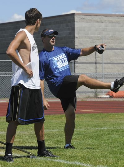 Mike Hollis, right, former, NFL, University of Idaho and Central Valley High School kicking standout, works with Zach Mohr, 16 of Deer Park, during Hollis' kicking camp July 23 at CV. (Dan Pelle)