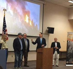 Oregon Sen. Ron Wyden speaks at the National Interagency Fire Center in Boise on Wednesday, May 2, 2018; from left are Acting U.S. Forest Service Chief Vicki Christiansen, Idaho Rep. Mike Simpson, Idaho Sen. Mike Crapo, and at right, Idaho Sen. Jim Risch.