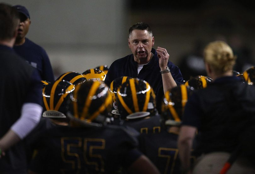 FILE – Bellevue's former Head Coach Butch Goncharoff encourages his team to focus during a time out at the class 3A state football title game between Bellevue High School and Eastside Catholic High School at the Tacoma Dome, Friday, December 4, 2015. Goncharoff was fired from his coaching position in 2016 after a report that detailed rule violations in the school's football program. (Sy Bean / The Seattle Times)