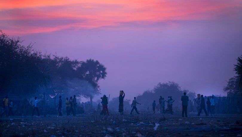 Displaced people who fled the recent fighting between government and rebel forces in Bor, prepare to sleep in the open at night in the town of Awerial, South Sudan Wednesday, Jan. 1, 2014. The international Red Cross said Wednesday that the road from Bor to the nearby Awerial area