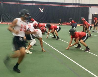Eastern Washington football players were forced to practice inside on Tuesday. (Jim  Allen / The Spokesman-Review)