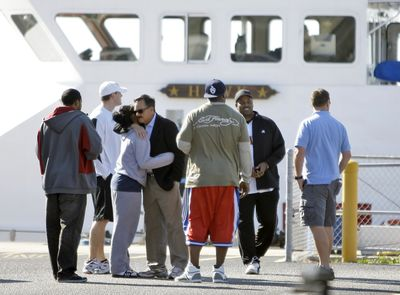 Family and friends of three missing fishermen, including two NFL players, meet Tuesday at the U.S. Coast Guard station in St. Petersburg, Fla. (Associated Press / The Spokesman-Review)
