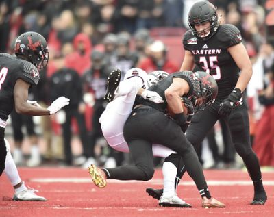 Eastern Washington  defensive back Mitch Fettig  secures an interception against Montana. (Tyler Tjomsland / The Spokesman-Review)