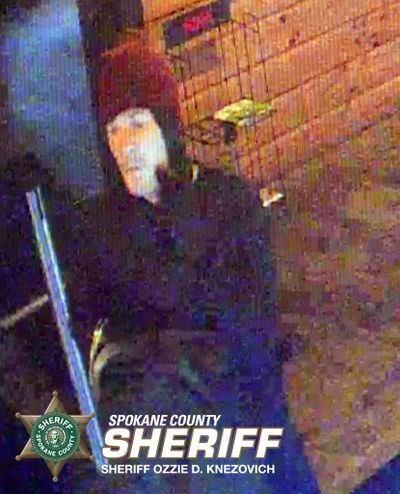 A surveillance photo shows a man Spokane County Sheriff's Office detectives believe robbed pot shop Greenlight on Monday, Aug. 3, 2015. Two men are believed to have robbed the store in a