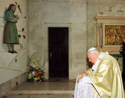 Pope John Paul II prays by the tomb of Jacinta Marto  May 13, 2000, in Fatima, central Portugal, after the beatification ceremony of Jacinta and Francisco, two of the three shepherd children who claimed the Virgin Mary appeared to them in 1917.  (File/Associated Press / The Spokesman-Review)