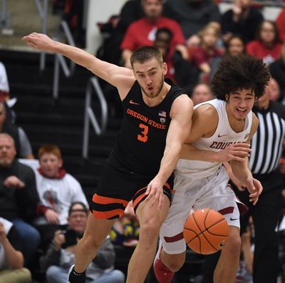 Oregon State forward Tres Tinkle (3) and Washington State forward CJ Elleby (2) chase a loose ball during a college basketball game, Sat., Jan. 18, 2020, in Pullman, Wash. (Colin Mulvany / The Spokesman-Review)