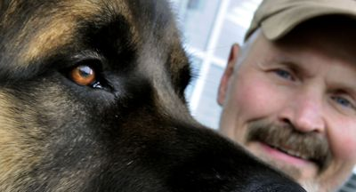 Caliber is a certified pet companion dog for Hospice of North Idaho. His owner is Dave Neptune.   (Kathy Plonka / The Spokesman-Review)