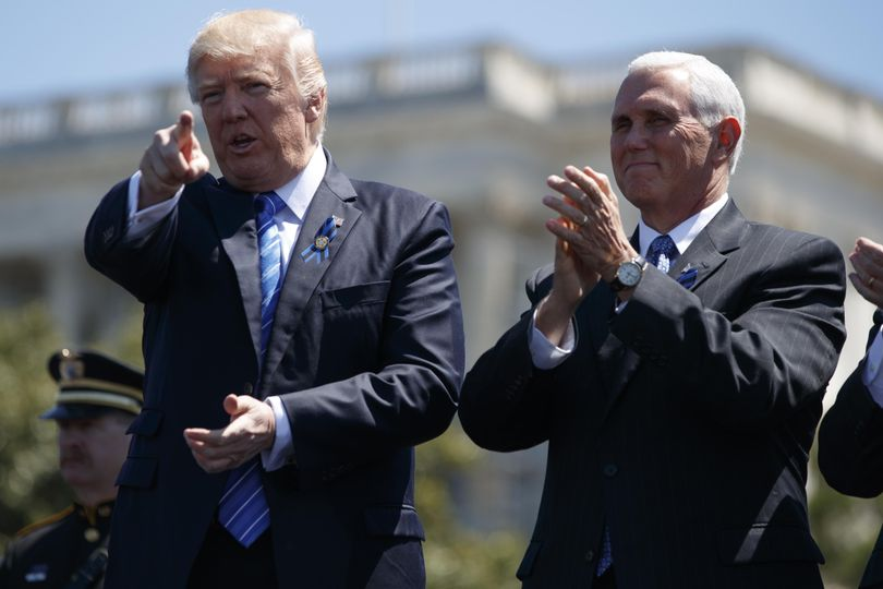 President Donald Trump stands with Vice President Mike Pence during the 36th annual National Peace Officers Memorial Service, Monday, May 15, 2017, on Capitol Hill in Washington. (Evan Vucci / AP)