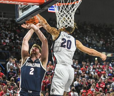 Gonzaga forward Kaden Perry meets Drew Timme at the rim for a blocked shot during Kraziness in the Kennel on Saturday.  (Dan Pelle / The Spokesman-Review)