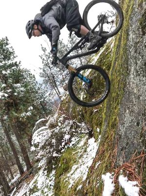 "Mountain biker Dan Wilson plummets down an ""advanced"" roller feature at Beacon Hill/Camp Sekani area. The rock is a purely optional route just above the trail Old School. ( Chris Madunich  / Evergreen East)"