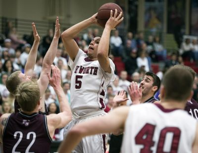 Whitworth guard Kenny Love looks to score in a crowd during first-half action on Thursday at Whitworth. (Colin Mulvany / The Spokesman-Review)