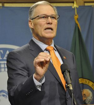 OLYMPIA -- Gov. Jay Inslee tells reporters Washington will fight efforts by the federal government to interfere in the state's legal marijuana system.  (Jim Camden/The Spokesman-Review)