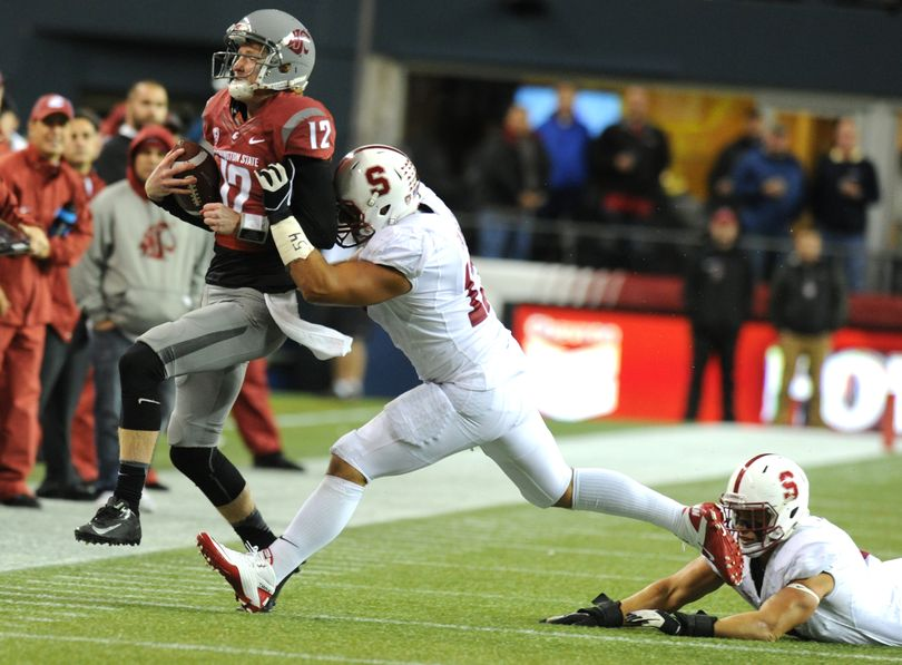Washington State quarterback Connor Halliday is forced out of bounds against Stanford during the first half of a college football game on Saturday, September 28, 2013, at Quest Field in Seattle, Wash. Stanford led 17-3 at the half. (Tyler Tjomsland / The Spokesman-Review)