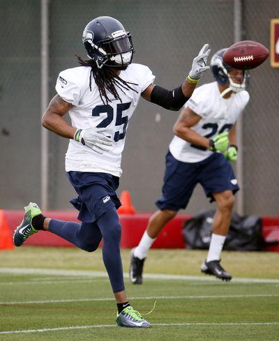 Seattle Seahawks' Richard Sherman runs through drills during a team practice on Wednesday. (AP)