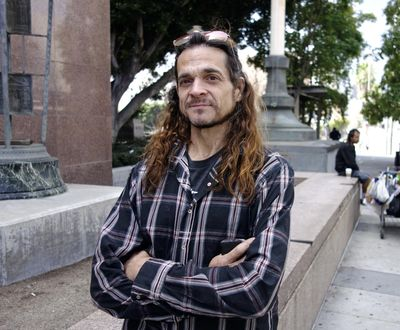 Matthew Lentz, who says he was fathered by convicted murderer Charles Manson at an orgy, stands outside Los Angeles Superior Court Tuesday, May 8, 2018. He carried letters he said Manson sent him from prison and hoped to show them to a judge at a hearing over claims on Manson's estate. But he arrived too late for the hearing, and has until July 13 to show cause why he shouldn't be dismissed from the case. (Brian Melley / Associated Press)