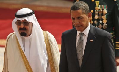 President Obama walks with Saudi Arabia's King Abdullah during Wednesday's arrival ceremony at King Khalid International Airport in Riyadh.  (Associated Press / The Spokesman-Review)