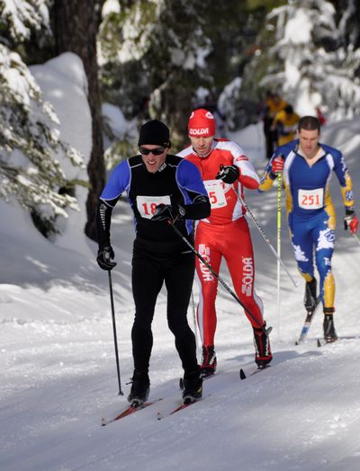 Brad Bauerof Seattle, middle,bides his timebehind James Rucker of Whitefish, Mont., in the firstfew minutes of the 35th annnual Spokane Langlauf 10-kilometer cross-country ski race at Mount Spokane State Park. Bauer, 39,soon broke away to win the 10-kilometerclassicevent in 26:19, four minutes ahead of second-place Rucker and the field of 244 racers.Deb Bauer of Spokaneled the womenin 32:20, beating runner-up Grace Fordof Spokane. See results on page B4 and a photo gallery from the race online at www.spokesman.com/ blogs/outdoors. (Rich Landers)