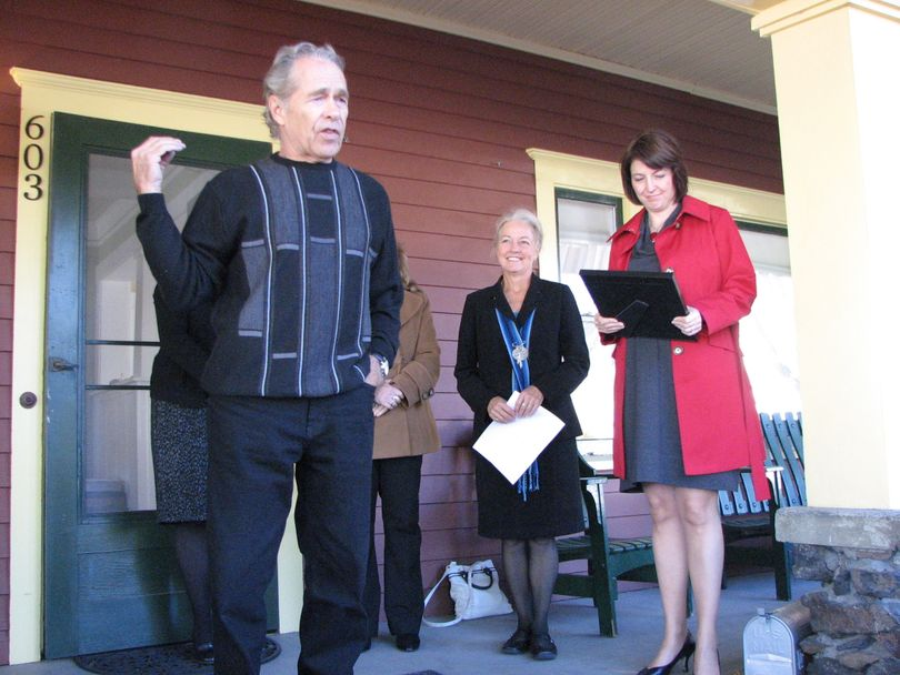 Owner of the Sonora Smart Dodd House - the Father's Day House - Jerry Numbers stand on the front porch together with Mayor Mary Verner and U.S. Representative Cathy McMorris Rodgers. The home was added to the National Historic Places and named