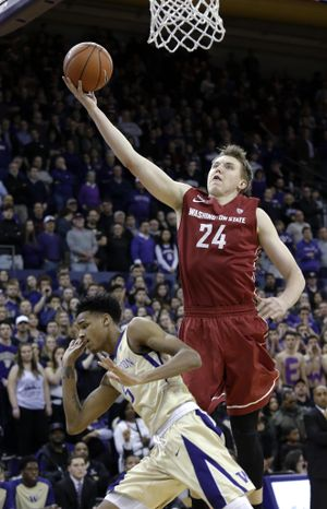 Washington State's Josh Hawkinson (24) shoots as Washington's Dejounte Murray defends during the first half of an NCAA college basketball game Wednesday, March 2, 2016, in Seattle. (Elaine Thompson / Associated Press)