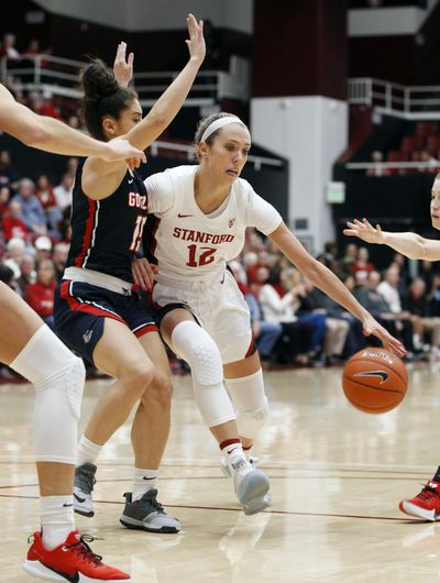 Stanford's Lexie Hull (12) drives for the basket as Gonzaga's Jessie Loera defends during the first half of an NCAA college basketball game Sunday, Nov. 17, 2019, in Stanford, Calif. (George Nikitin / Associated Press)