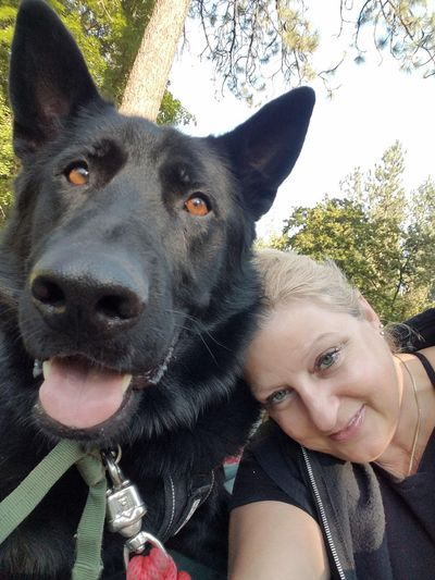 """Laura Renz and her former service dog, Vinny. The dog had to be pulled from service after he was rushed too many times by """"imposter"""" service dogs and became too reactive, she says. (COURTESY)"""