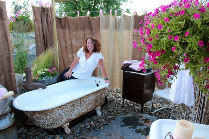 Kelly Tareski shows off the outdoor bathing suite on her Nine Mile Falls property near Spokane. (Cheryl-Anne Millsap / Photo by Cheryl-Anne Millsap)