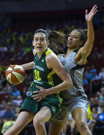 Seattle Storm's Breanna Stewart, left, is pursued by San Antonio Stars' Dearica Hamby during a WNBA basketball game at KeyArena, Wednesday, July 20, 2016 in Seattle. Stewart, the Storm's rookie of the year, will be one player featured in the WNBA's opening game on ESPN on May 13, 2017. (Sy Bean / Assocaited Press)