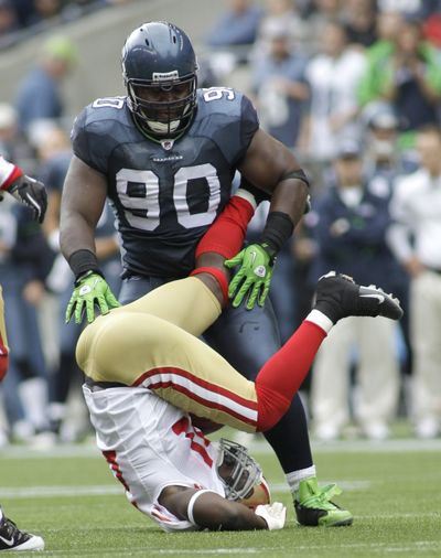 Lineman Colin Cole and the rest of the Seahawks' defense did a solid job of keeping Frank Gore off balance and upending the 49ers in the season opener on Sunday. (Associated Press)