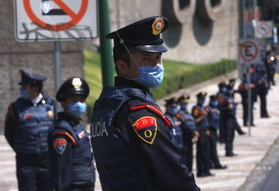 Riot police stand in front of Mexico's National Autonomous University soccer stadium, which was closed to the public, shortly before a game with Chivas in Mexico City on Sunday.  (Associated Press / The Spokesman-Review)