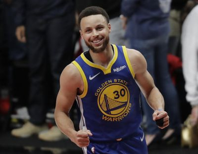 Golden State Warriors guard Stephen Curry reacts at the end of Game 4 of the NBA Western Conference finals against the Portland Trail Blazers on Monday night  in Portland. (Ted S. Warren / Associated Press)