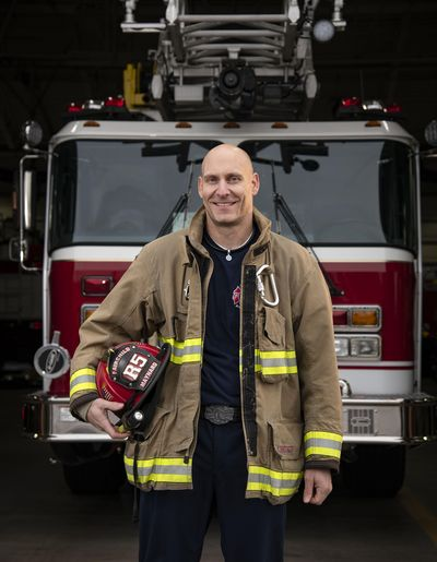 Kris Maynard, 42, a Mead resident and civilian firefighter and EMT at Fairchild Air Force base also works with his wife to raise awareness about diabetes along with the message that many people are prediabetic and don't know it. (Colin Mulvany / The Spokesman-Review)