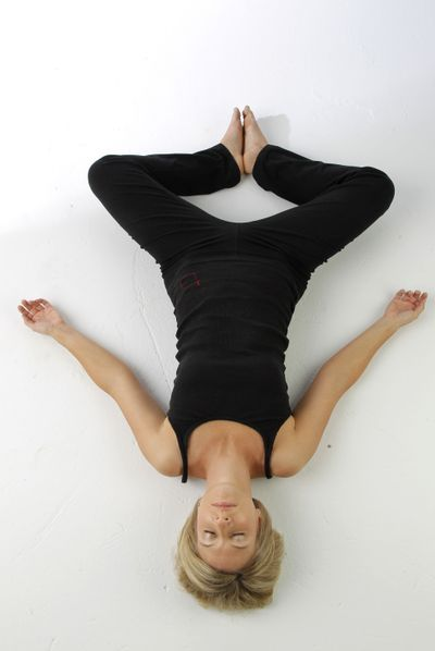 Meredith Smith demonstrates the yoga pose, reclining butterfly.