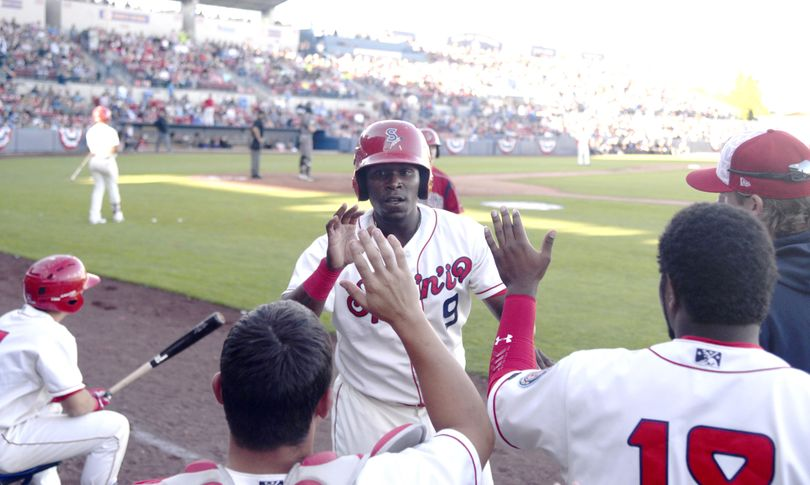 Xavier Turner of the Spokane Indians is congratulated at the dugout for scoring in the third inning against the Boise Hawks on July 4 at Avista Stadium. Turner is one of four NWL All-Stars representing the Spokane Indians. (Jesse Tinsley / The Spokesman-Review)