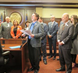 A group of lawmakers from both houses, led by Sen. Cliff Bayer, R-Meridian, announce they've gathered 48 cosponsors for legislation to repeal Idaho's sales tax on groceries.  (Betsy Z. Russell)