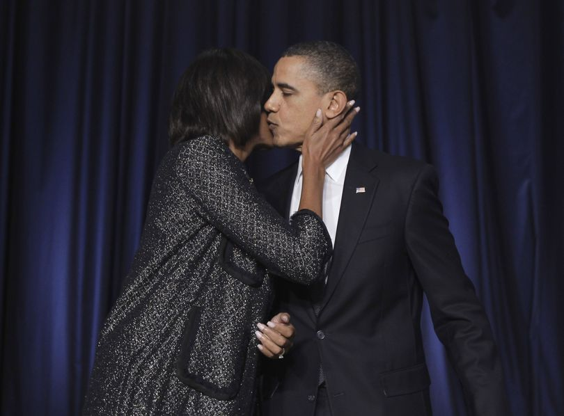 President Barack Obama gets a kiss from first lady Michelle Obama after he spoke at the National Prayer Breakfast in Washington, Thursday, Feb. 3, 2011. (Charles Dharapak / Associated Press)